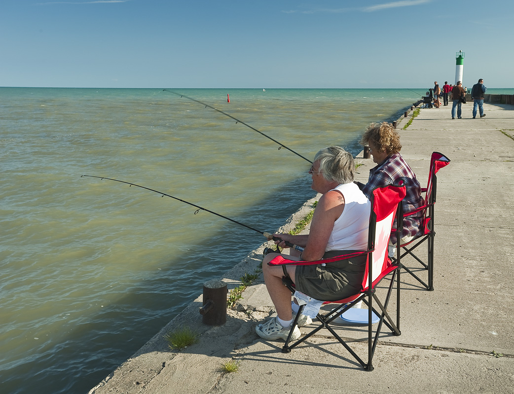 Women fishing on pier